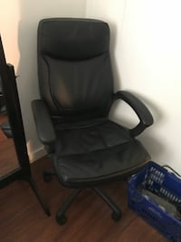 Black leather office rolling armchair New York