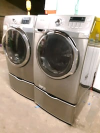 SAMSUNG FRONT LOAD WASHER AND DRYER SET WITH PEDESTAL WORKING PERFECTL Baltimore, 21201