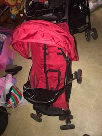 Baby's red and black stroller 3152 km
