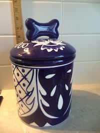 blue and white ceramic dog treat jar with lid