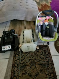 baby's black and white car seat carrier