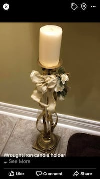 Wrought iron candle holder with candle and floral