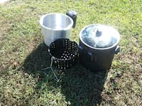 two round black metal containers 833 mi