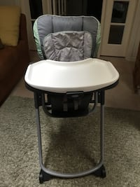 baby's gray and white highchair