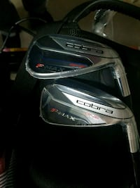 New never used cobra irons still in rapping