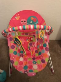 baby's pink, green, and purple polka-dot b ouncer