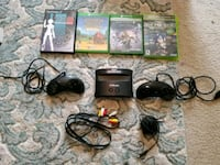 black Xbox 360 game console with game cases 2308 mi
