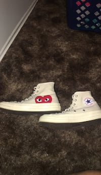 Pair of white converse high-top sneakers