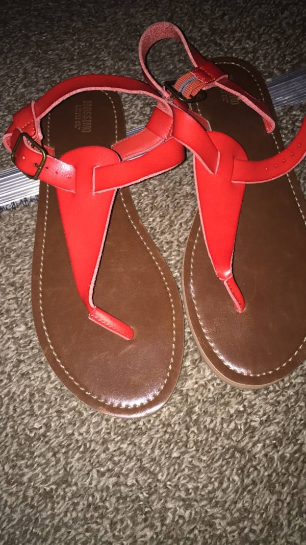 Pair of red-and-brown leather sandals