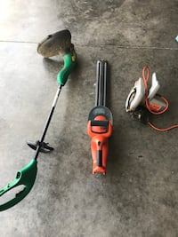 green electric string trimmer and orange hedge trimmer