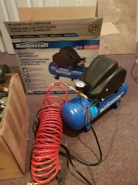 blue and black Mastercraft air compressor with box Corner Brook, A2H 1R4