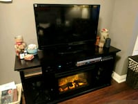Black wooden TV stand with electric fire place Vaughan, L4J 0H9