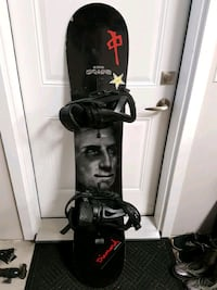 black and red snowboard with bindings Kelowna, V1X 1L8