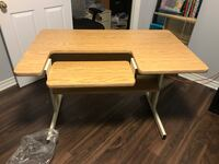 brown wooden computer table