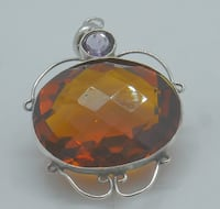 STERLING SILVER PENDANT WITH ORANGE AND PURPLE STONE 9.4 GRAMS PRE OWNED  Baltimore, 21205