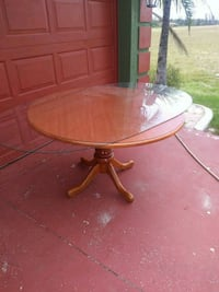 round brown wooden pedestal table Cape Coral, 33993
