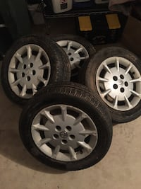Gray nissan multi-spoke vehicle wheels 24 km