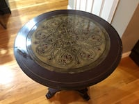 Round black wooden framed glass top coffee table Providence, 02910