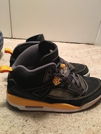 Black and gold yellow spizike jordans  size 11.5 Springfield, 07081