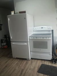 white top-mount refrigerator and stove (GE)