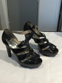 pair of black leather open-toe heeled sandals Toronto, M9P 1Z1