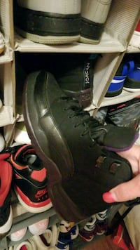 pair of black-and-green Nike basketball shoes Fall River, 02723