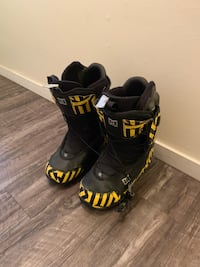 pair of black-and-yellow snowboard boots Vancouver, V6E 1Z9
