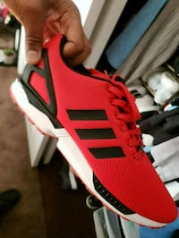 red and white Adidas, Casual shoes. 2327 mi