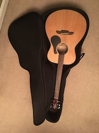 Brown acoustic guitar with case