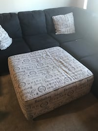 Square beige and blakc printed ottoman