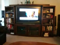 flat screen television with brown wooden TV hutch Long Beach, 90807