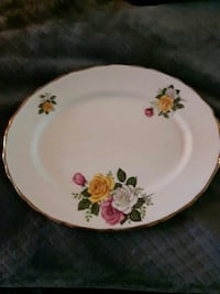 white multicolored floral ceramic plate