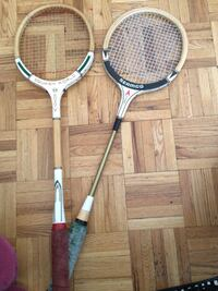 Two brown and white squash rackets 536 km