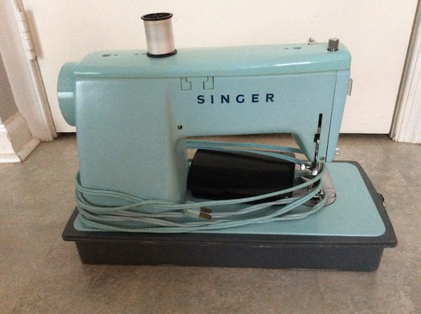 Blue and white sewing machine 4cd2effd-176f-4aff-8533-03e3d3cd6797