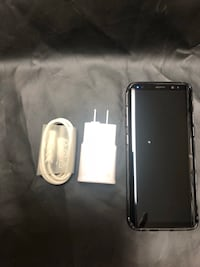 black Samsung Galaxy smartphone with white case Toronto, M9N 2S4