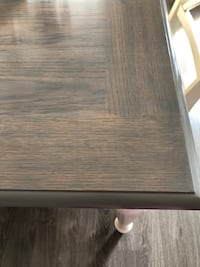 Rectangular greyed wooden table. With insert to make bigger. 4 chairs included. Minor flaws  Tiny, L0L 2T0