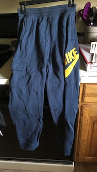 blue and yellow Nike cargo pants