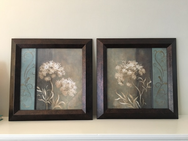 Two black wooden framed painting of flowers