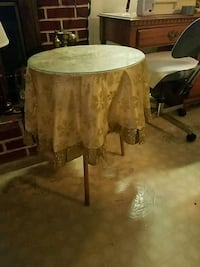 Small table with gold cloth and glass top Emmitsburg, 21727