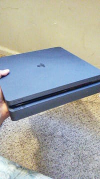 black Sony PS4 game console