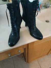 pair of women's black leather knee-high lace-up boots Melbourne, 32940