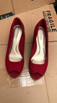 Pair of red peep-toe heeled shoes. size 6 1/2
