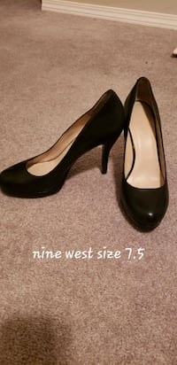 pair of black leather heeled shoes Calgary, T2P 0H5