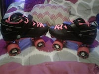 pair of black and pink roller skates