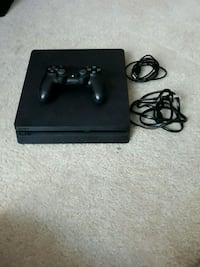 black Sony PS4 console with controller Woodbridge, 22191