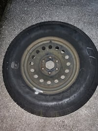 One brand new truck tire and rim