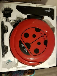red and black Kobot home appliance