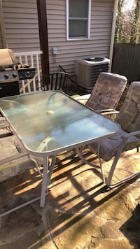Patio Table and 4 chains including cushion. Umbrella holder great condition   Falls Church, 22042