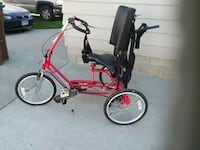 red and black bicycle with training wheels Minneapolis