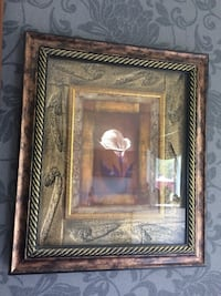 brown wooden framed painting of woman Newmarket, L3Y 5C4